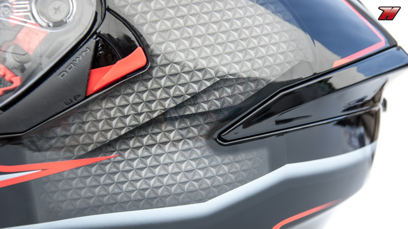 Detail of the rear side of the helmet, with the sun visor mechanism and the  rear spoiler